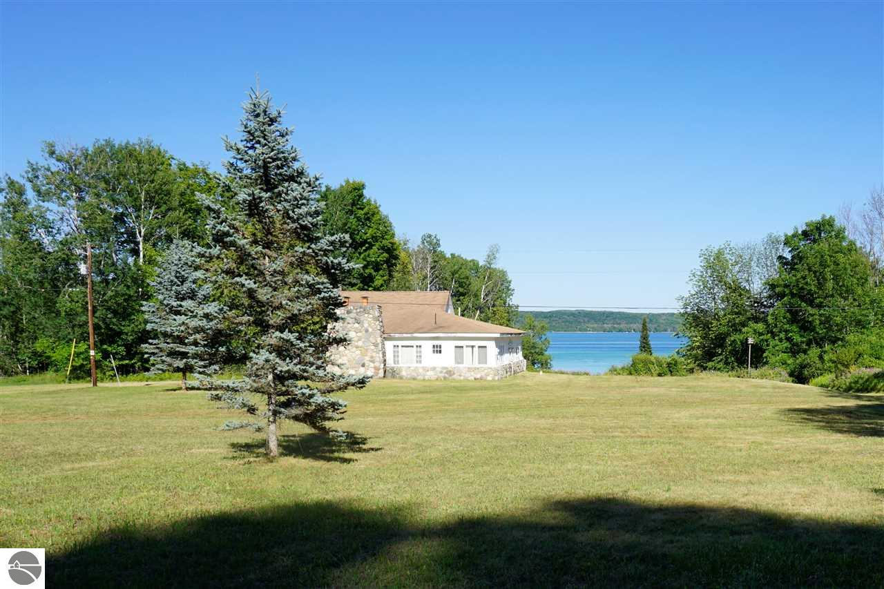 Property for sale at 651 NW Torch Lake Drive, Kewadin,  MI 49648