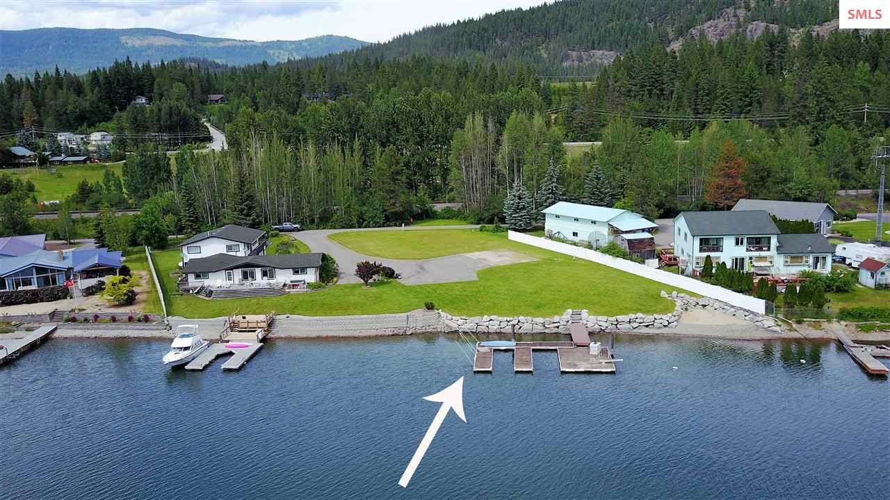 Beautiful Waterfront parcel with 125 feet of shoreline, lawn to the water's edge, permitted dock with 2 boat slips, your own sandy beach and 1.4 acres. Southern exposure, beautifully landscaped with expansive views of the water & the mountains. Sewer was hooked up when the original house was on site. Beautiful lawn with sprinkler system & rip-rapped shoreline. Build your dream home & enjoy what Idaho has to offer; boating, canoeing, kayaking hiking, snow skiing & so much more.  Now all it needs is your home. Outstanding location in snug harbor & so close to Dover Bay and Sandpoint! Owner maybe finance!