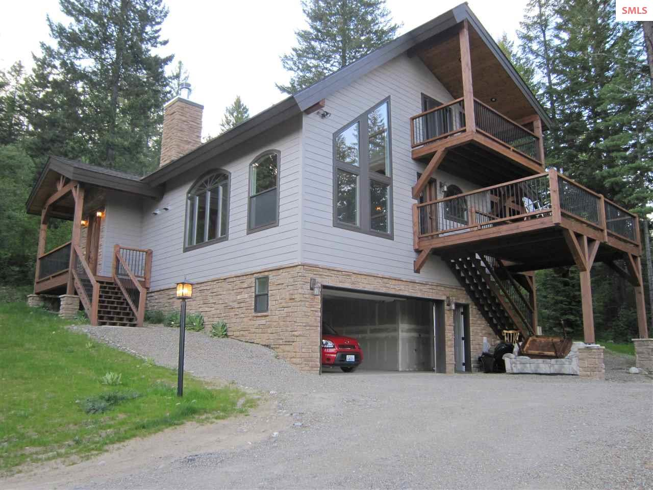 """Craftsman 3 bed 2 bath with 2424 ft on 1.52 acres. Lots of upgrade such as Knotty Alder Wood doors,High end Kitchen cabinets (Alder) and appliances with built-in oven units, as well as include cooktop w/downdraft, trash compacter, and instant hot water and custom ceramic tile on walls & floor. First floor bathroom has shower/tub combo w/ rainglass doors, and custom ceramic tile thru-out. 44"""" wood burning Fireplace, Master bedroom with 2 walk-in closets and balcony w/ view of lake. -Master bath has double hickory vanity w/granite counter, whirlpool, rain glass shower unit and tubular skylight. High efficiency Heat pump. Huge red cedar deck to enjoy the view. There is so much more! Worth a look! Only a few miles to Garfield Bay where there is marina and restaurant.  Original home-owner custom design......every little detail was thought out with this home"""