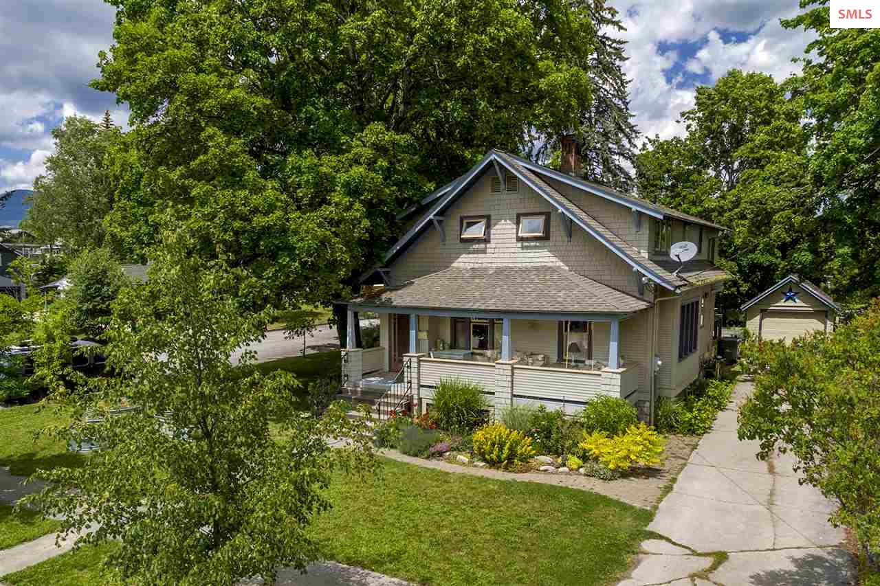 Coveted S. Sandpoint Location!!  Classic 2200 sq. ft. home w/ 3 bdrms/3 baths, sits on lg corner lot one block away from Lake Pend Oreille.  Style and charm, beginning with the large front porch, which acts as additional outdoor gathering area.  Inside are wood floors, leaded-glass windows, gas fireplace – vintage style but with all the modern conveniences.  Kitchen features granite countertops, stainless steel appliances, farm sink, gas stove, solid butcher-block island, in-floor heat, and is open to a light/bright dining area.  Mstr bdrm has walk-in closet, beautiful en suite bathroom w/shower, soaking tub, radiant floor heat. Large fenced back yard, garden area, mature landscaping.  Washington school zone.  Blocks fr Memorial Field, downtown, lake, parks and all our wonderful amenities.