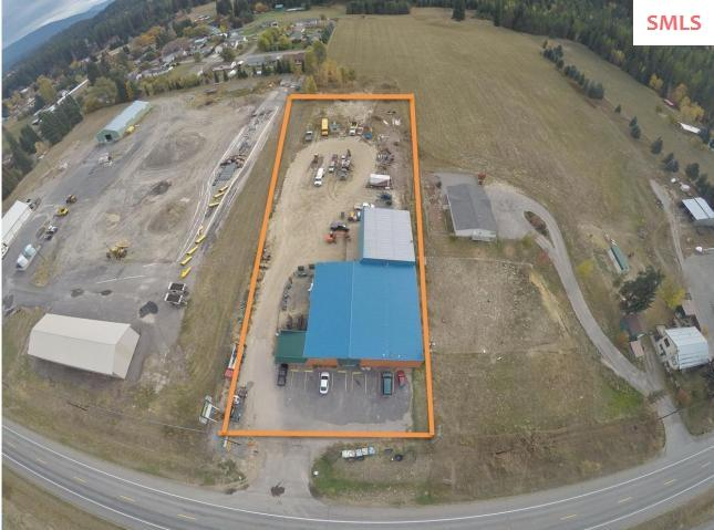 Two commercial acres, over 9,500 square of Warehouse/commercial building, great fronting US Highway 95! Lots of power. 100% leased. Current strong tenants on short term leases but with long history. Room for more buildings or plenty of yard space. Owner carry possible.