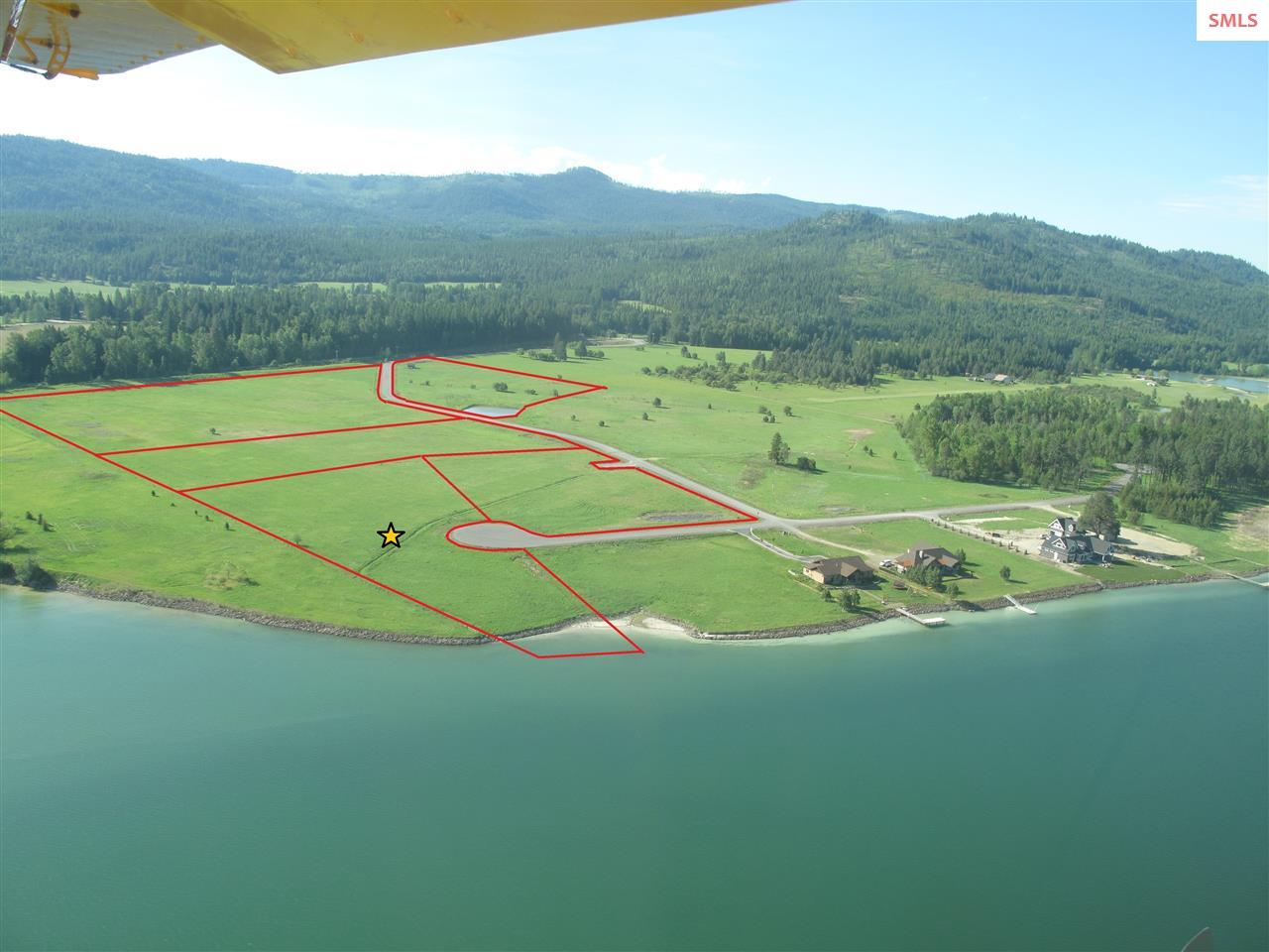The RANCH at RIVERBEND - 4 level acre lot on the Pend Oreille River with incredible 360 degree views of the River & Mountains. Paved roads, utilities in, and ready to build! Private 80 feet of Pend Oreille River Waterfront, this lot makes for a spectacular build site for your dream home. Not only do you get stunning views but the location is situated a mere 15 min from downtown Sandpoint, shopping, restaurants and the beach, all while still enjoying the privacy and quite that living out of town brings.