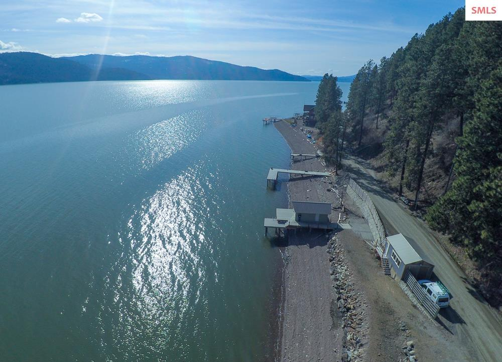 The Ultimate Lake Pend Oreille Waterfront Property. Features 250+ Feet of Crystal Clear Lake Frontage, situated on over 2 acres, a Level Bluff Building Site with Expansive Views to The East, South and West. Other Amenities Include New Dock with an over the water (day cabin) , Extensive Retaining Wall Work has been done  to Create an Amazing Private Beach Area. Bring your RV for The Perfect Summer Camp Or Build Your Year Round / Vacation Home. Property has an Approved Septic System and Well Installed. Easy Access to Down Town Sandpoint. Turn Key and Ready, Call Your Agent for A Private Showing Today !