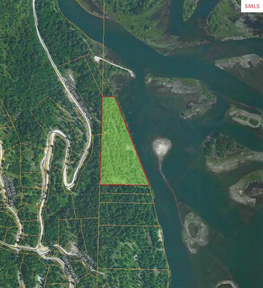 900 Feet of Prime Waterfront on the Pack River!! With 8 acres, this is a great site for a family compound or lodge with easy  access to the Idaho Club. This site is also key to a road extension to access 8 parcels all the way to the railroad to the south.