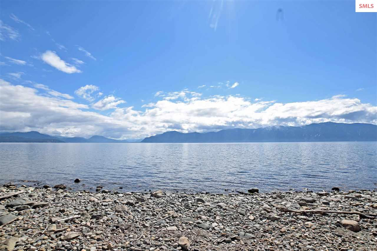 First time on market in over 50 years!  Outstanding waterfront lot.  Unmatched views of Lake Pend Oreille and the Monarch Mountains.  Perfect setting to build your custom, dream home.  Awesome neighborhood!  Make your Idaho lakefront dream come true!