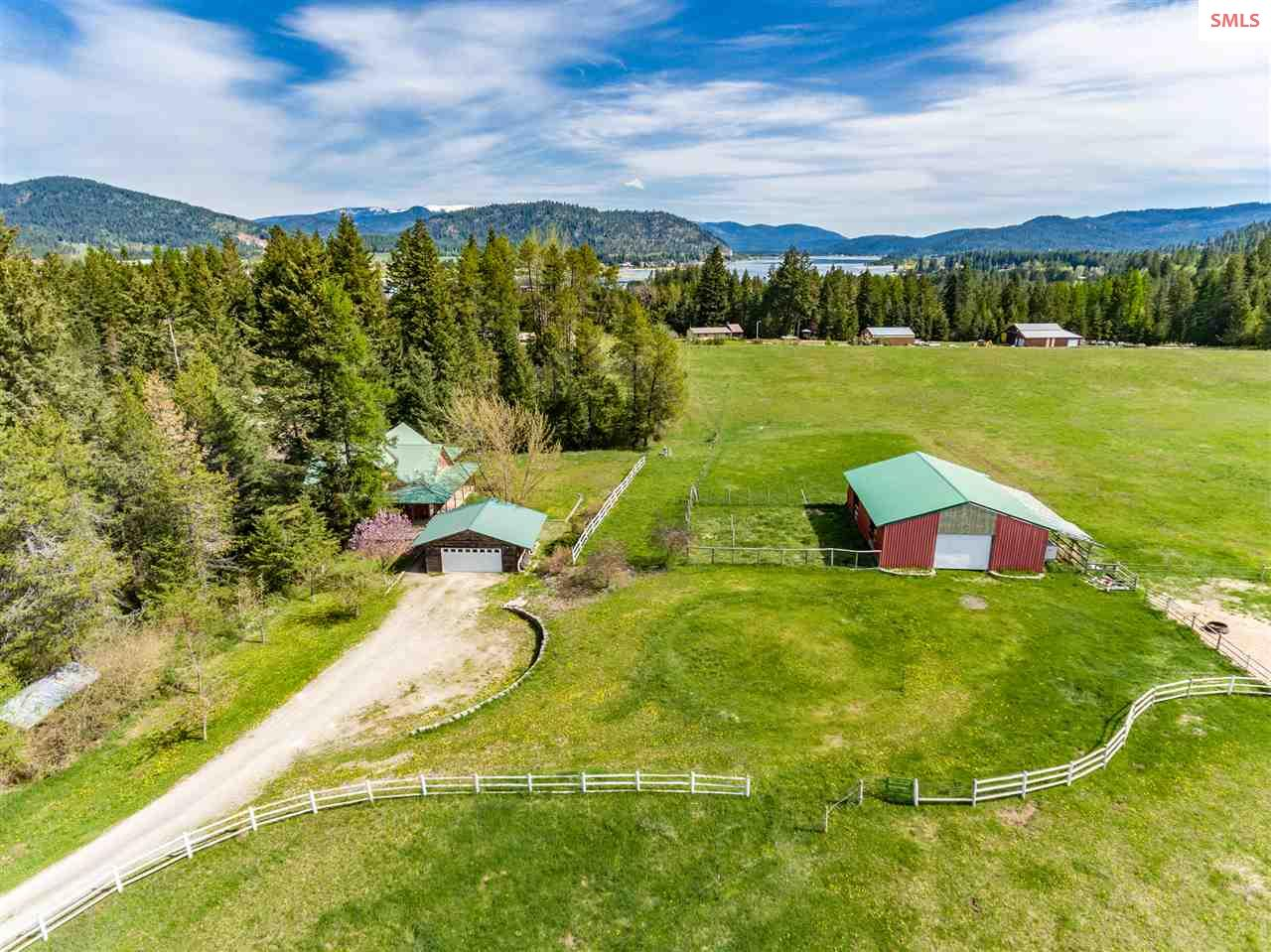 LARGE 6BR/4BA HOME SITUATED ON 30 ACRES WITH DETACHED GARAGE AND 60X60 BARN SETUP FOR HORSES! 3,960 sq ft home features TWO main floor master suites, office, huge family room, large bonus room, granite in kitchen and so much more! All usable 30 acres fenced and cross fenced with three pastures. 2 car detached garage with concrete floor and power. 60X60 Barn with power, four stalls, tack room & lean to. Beautiful property on county maintained road and nearly 2 miles to Jewel Lake and 7 miles to Round Lake State Park!