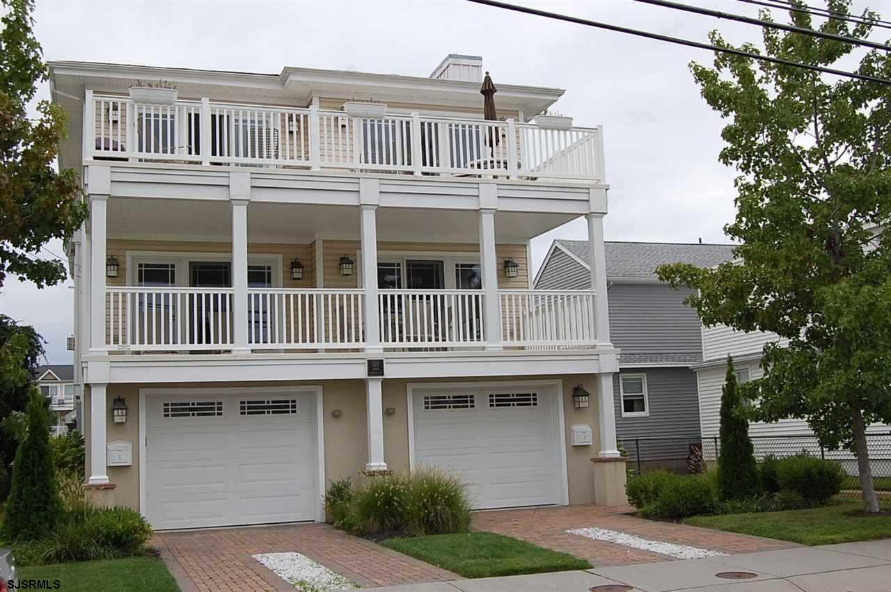 2377 SqFt 7 YEAR OLD SINGLE FLOOR CONDO IN LIKE NEW CONDITION WITH LOTS OF UPGRADES. 4BR, 2.5BA with 2-Car Garage and large storage room on garage level plus front and rear covered fiberglass decks. Shared back yard with sprinkler system.  Pavers in driveway and walkway to side entrance on left.