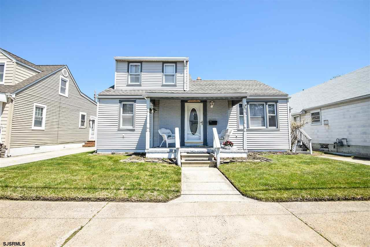 Quaint Cape Cod just 5 blocks from the beach in a quiet & great location. Features 3 nice size bdrms w/2 full, updated baths. One bedrm & bath on the main floor.  Large, recently updated eat-in-kitchen w/wall ovens and gas cooktop.  Nice size family room, could be your 4th bedrm, leads out to a covered Trex deck and into a nice size yard.  Fenced yard features an above-ground pool and storage shed.  Take down the pool & you'll have a good size yard for kids, dogs & BBQs.  Recent elevation cert greatly reduced flood insurance. Close to great restaurants, beach, boardwalk, bay, parks, casinos, etc.  Come check out this home & make it your own! Not a short sale!! Quick closing!