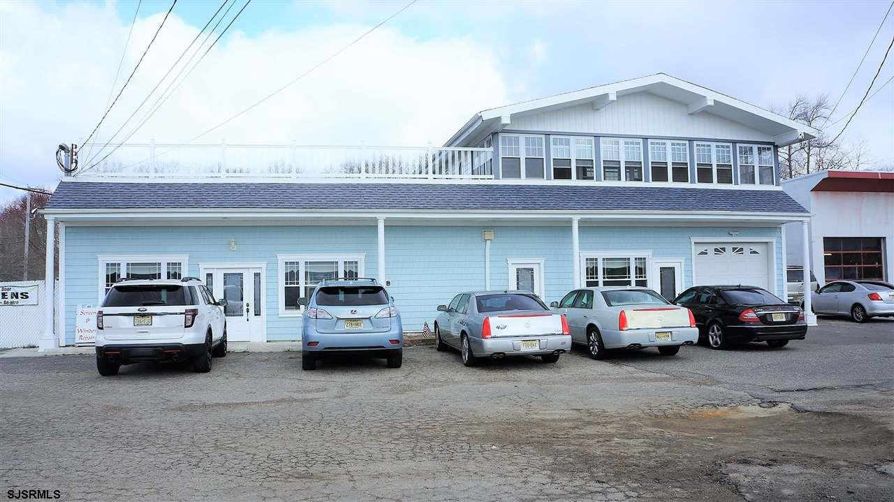UNIQUE INCOME PROPERTY (No Lease). Retail warehouse with large fenced in service yard. Finished retail area connected to warehouse. Large 2nd floor apartment separate entrances. All perfectly situated on high traffic/visibility location. Multiple uses could be accommodated.