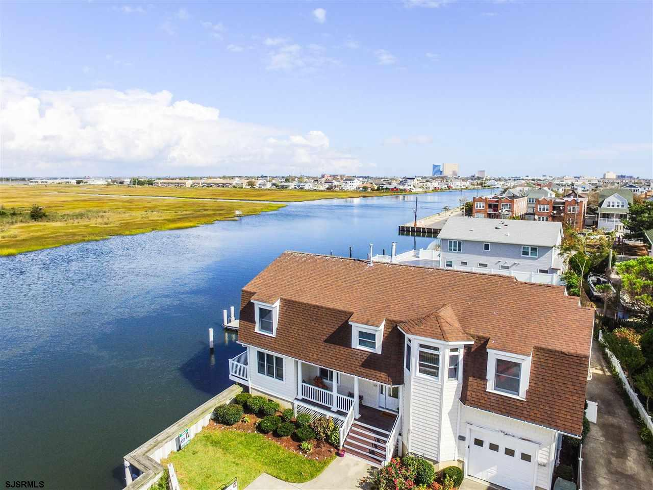 Waterfront home with boat slips & Bayfront garden for entertaining.Secluded street for Nature lovers