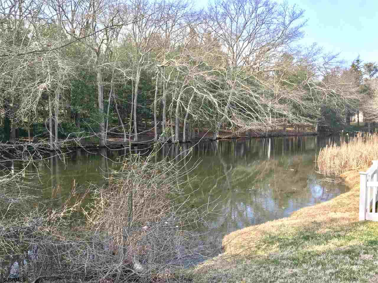 Rare opportunity to own oversized Eastside lot on quiet executive Private Lane with water views, surrounded by other luxurious custom homes. Pond views from every window in front of house...bay views depending on design. Agent has survey. All public utilities.