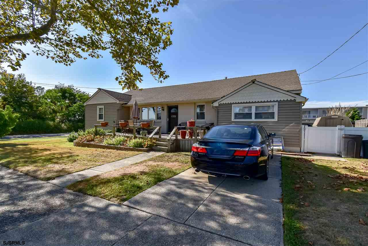 Beautifully renovated home in the desirable east-side location of Somers Point. The first thing you'll notice are the great views of the Atlantic City skyline from your front porch with your water views of the Bay. You have no obstructed views since no one can park in front of the Stop Sign in front of your new home. Short walking distance from night-life, restaurants and entertainment as well as a Marina. You are just minutes from the beaches of Longport, Ventnor & Margate. This home has three (3) bedrooms and three (3) full bathrooms. One of these rooms has it's own private entrance with a full bathroom and a kitchenette, perfect for a guest. It has it's own separate ductless cooling and heating system which can be controlled separately f