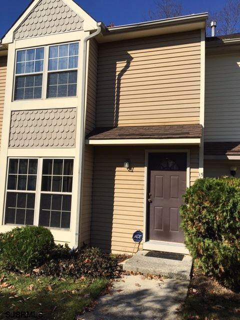 Home warranty included!Updated townhome, newer appliances, heat and central air, new carpet too.Relax by the cozy fireplace-outside is a shed for storage.  Close to shopping and minutes to Atlantic City.