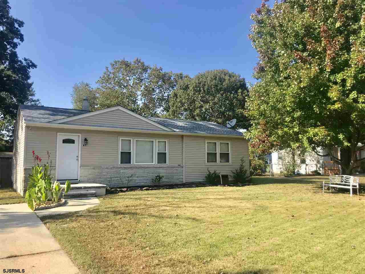 Recently renovated inside and out! Shows meticulously - maintained and clean! New stainless steel kitchen, new flooring, bath, roof, gas heat, central air. Vinyl siding, replaced tilt-in windows. Extra large, deep fenced in yard!!