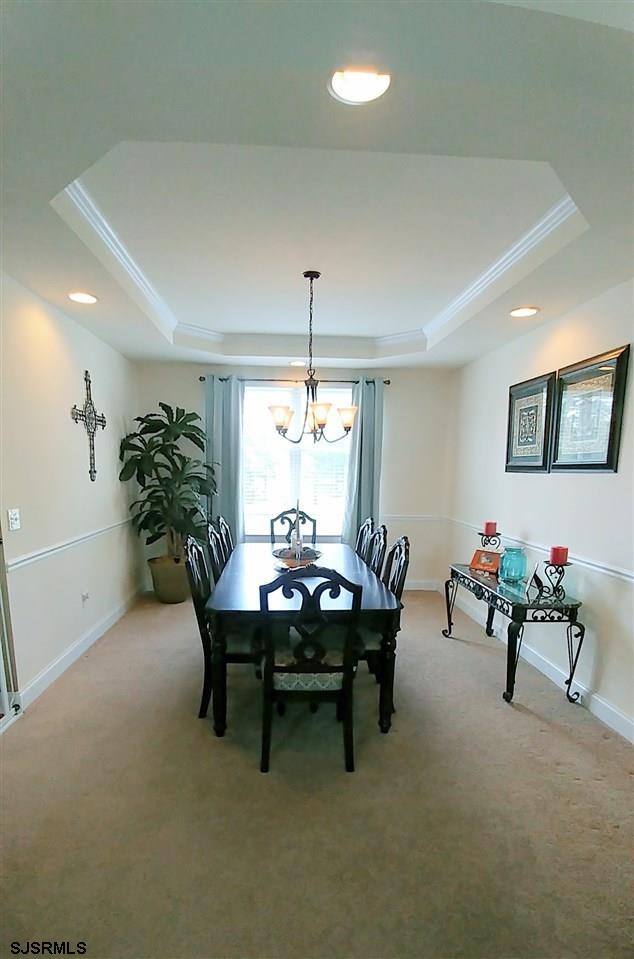 Formal dining room w/ tray ceilings & chair rail