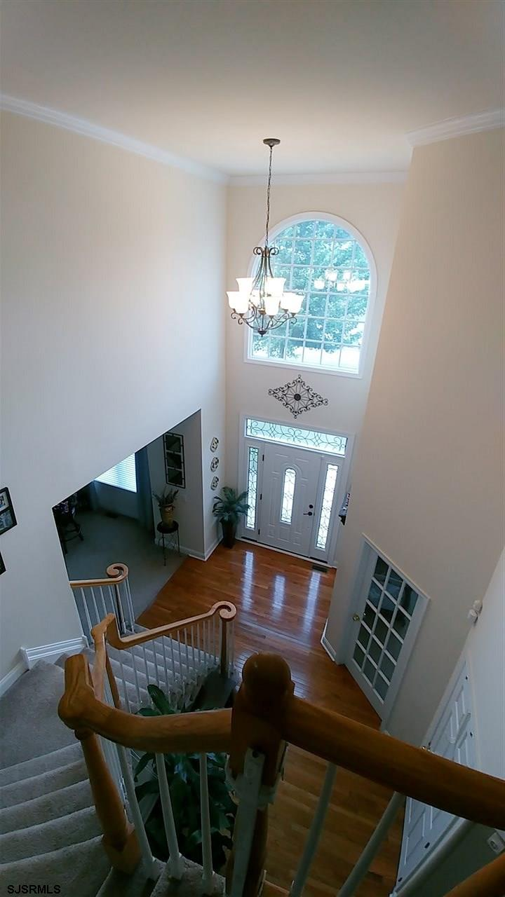 Bright & sunny foyer features motorized chandelier lift!