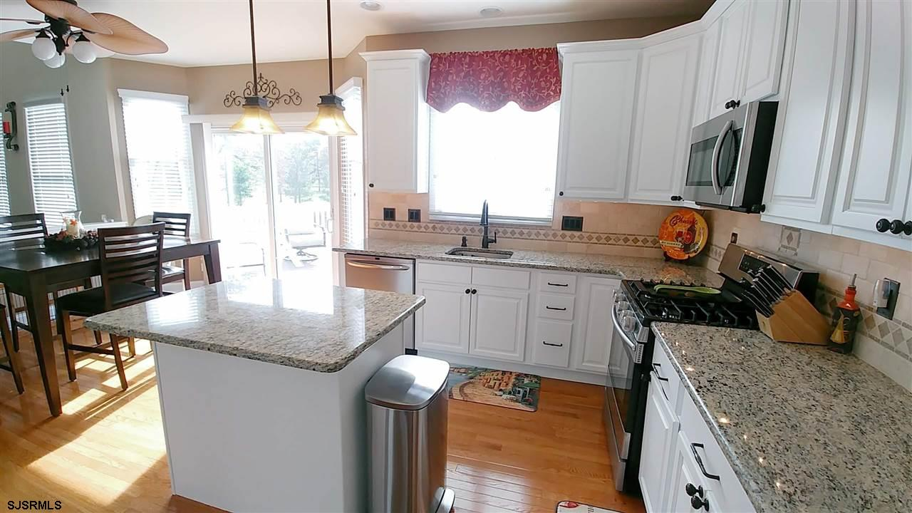 Granite/stainless kitchen has upgraded appliances & absolutely NO shortage of storage!