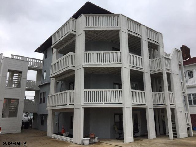 Beachblock location!  4 units in building/association. Subject is the entire top floor.  Wrap around