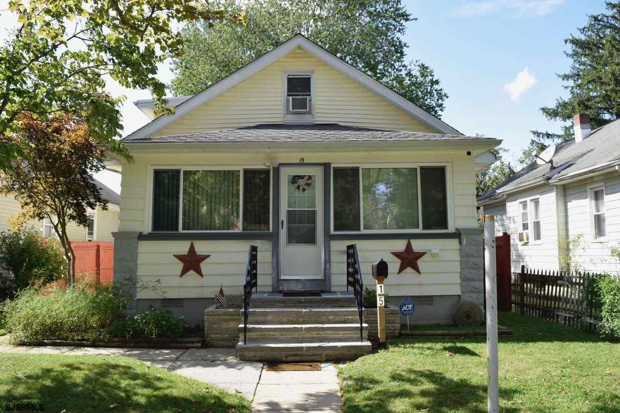 Lovely well maintained home.  Front porch was enclosed for additional living area.  2 bedrooms downs