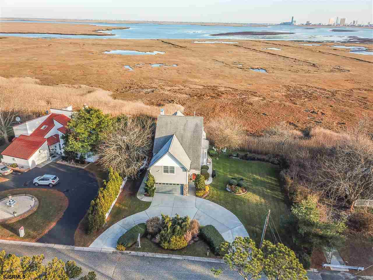 Spectacular unobstructed VIEWS of the bay, meadows, ENTIRE AC SKYLINE & BRIGANTINE! Immaculate 3 bed