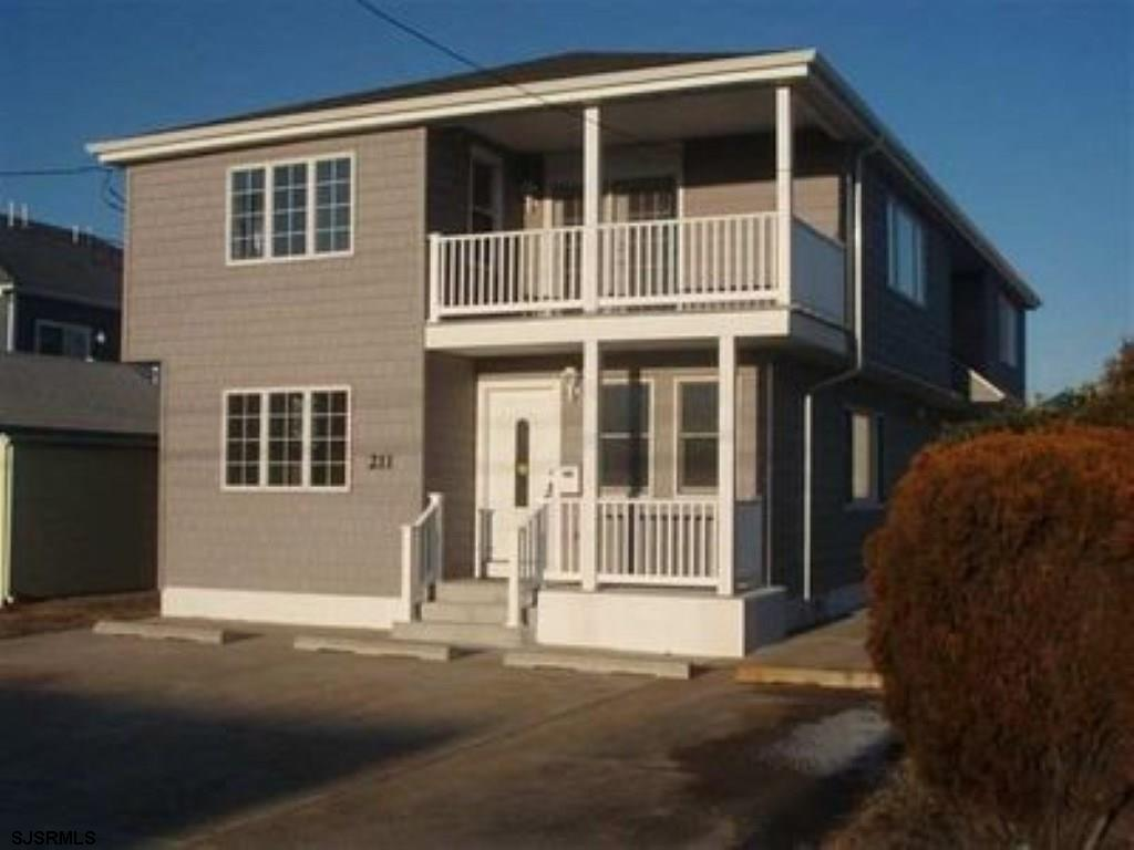 Beach Block opportunity second floor condo with three spacious Bedrooms two full baths open floor pl