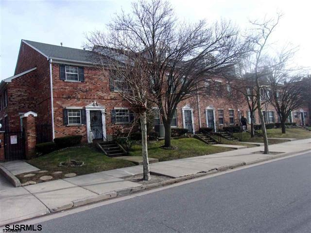 4 bed 2.5 2 story Brick Townhome in Gated Community Close to the Beach and Boardwalk. Attached two c