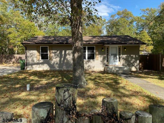 This move-in ready home has been recently updated: fresh paint, flooring, doors, stainless steel app