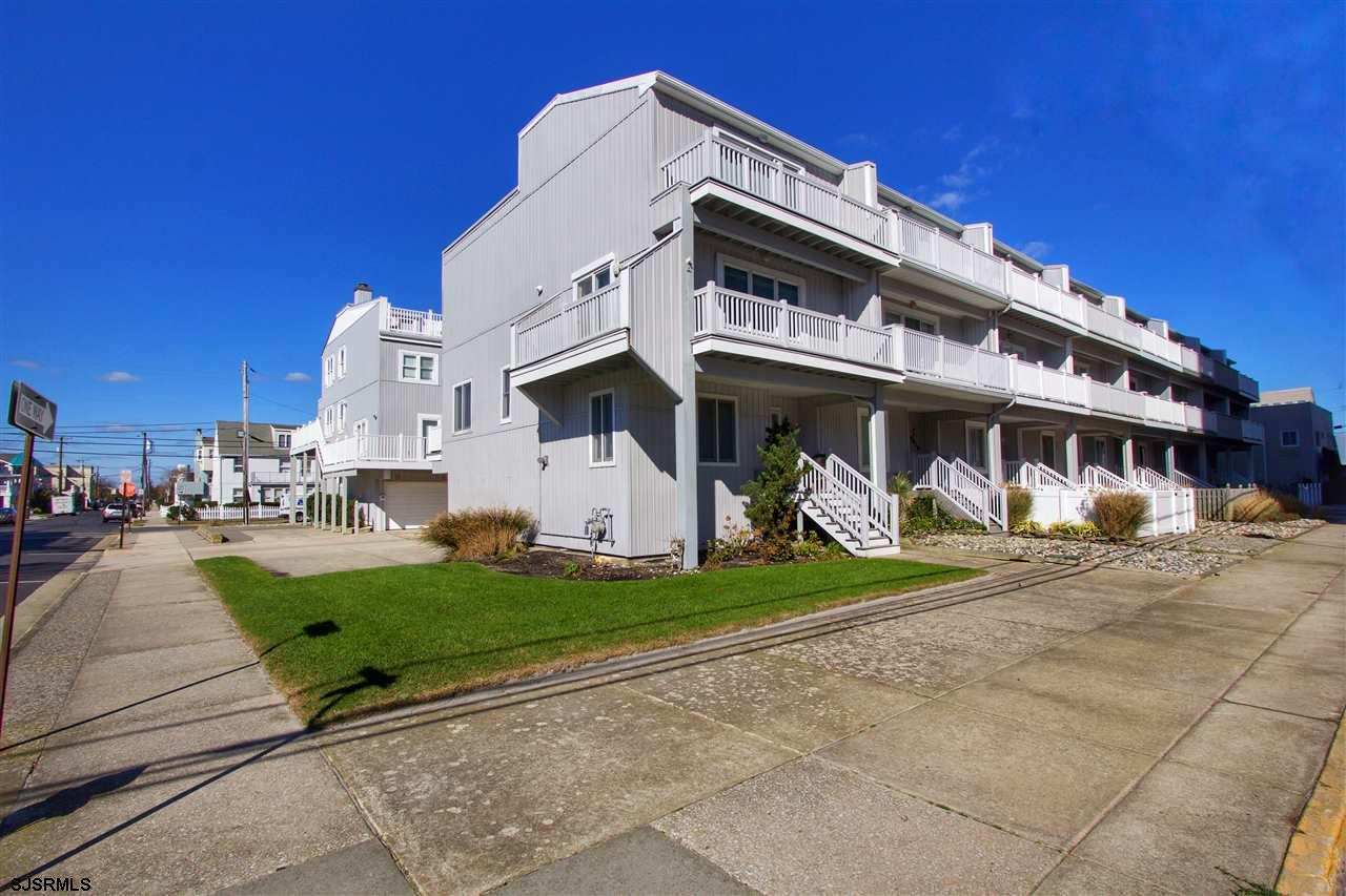 Across from the beach, this 4 bedroom, 2.5 bath end-unit townhouse features bamboo floors boasts ama
