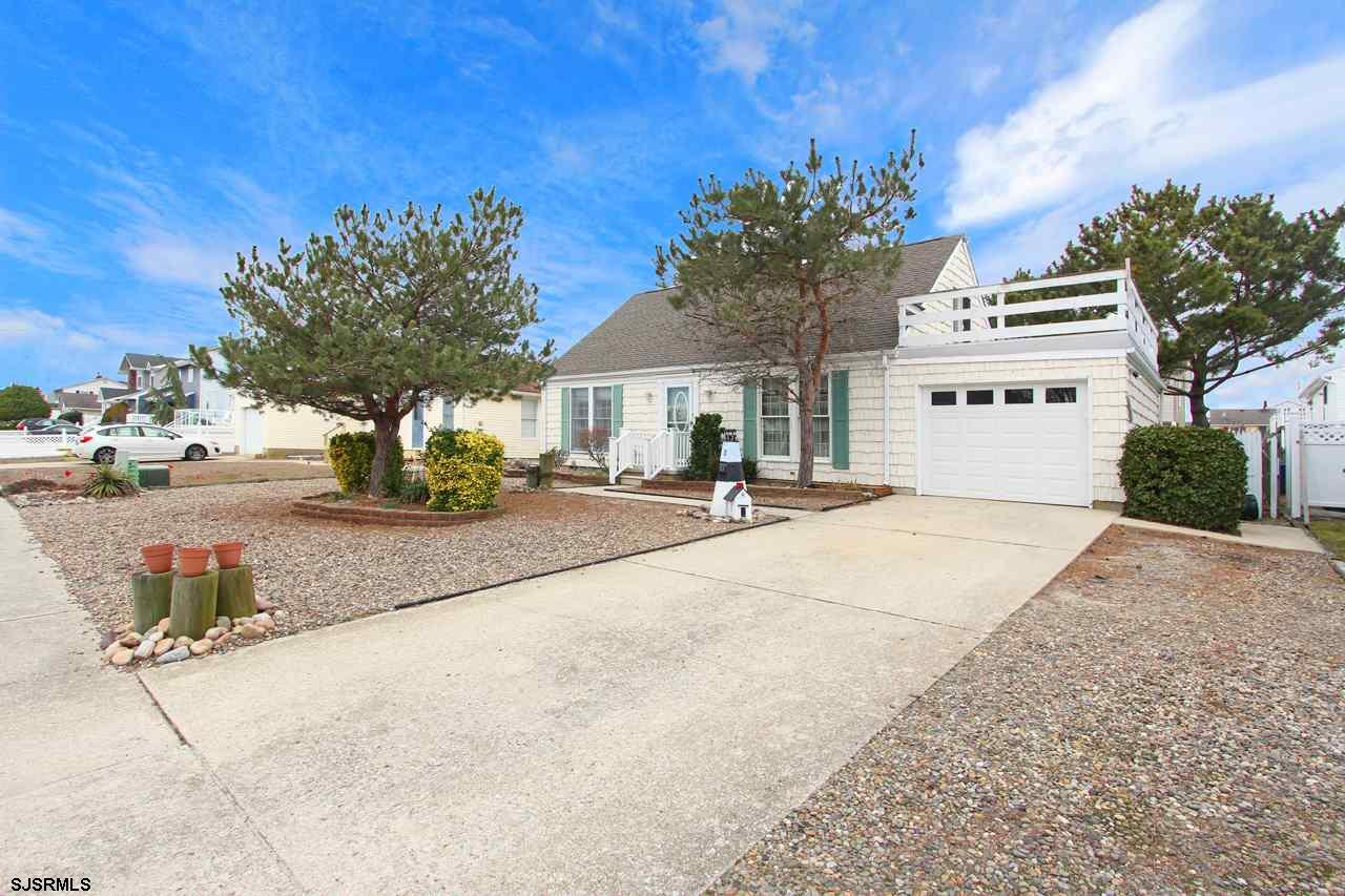 This 4 bedroom, 2 full bath, Cape Cod is situated on a large 60' x 100' lot on the Southern end of t