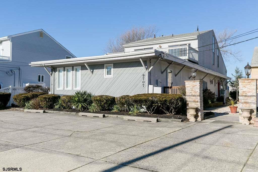 Welcome to 9707 Pacific Avenue. This south side 4 bedroom 3 bath townhome is steps away from the bea