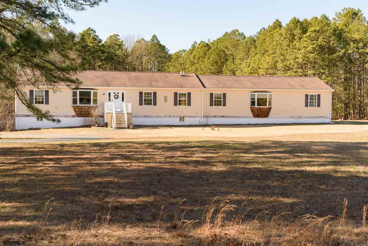 Hidden Gem in EHT!  Come see this very private property set off the road on a peaceful 7 acres.  2 h