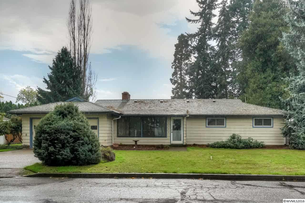 Recently updated on huge .47 acre lot. Fresh updates include new flooring, lights, bathroom counter tops plus so much more. Spic & span, move in ready! You will love all the space this home provides. Keep comfortable all year round with central heat & air plus extra warm & cozy with the wood-burning fireplace in the living room & a pellet stove in the family room. Large yard includes green house, redwood gazebo & raised garden beds. Must See!