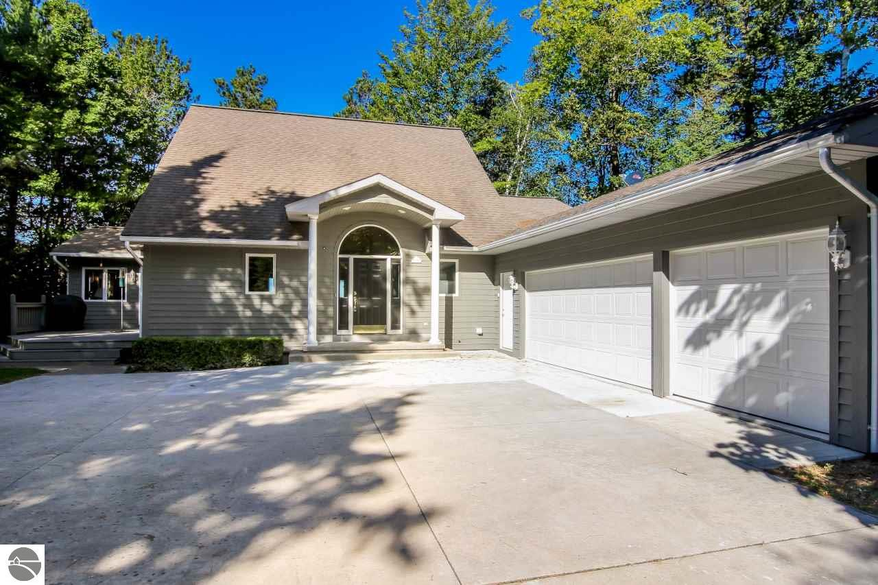 Property for sale at 357 N Golden Beach Drive, Kewadin,  Michigan 49648