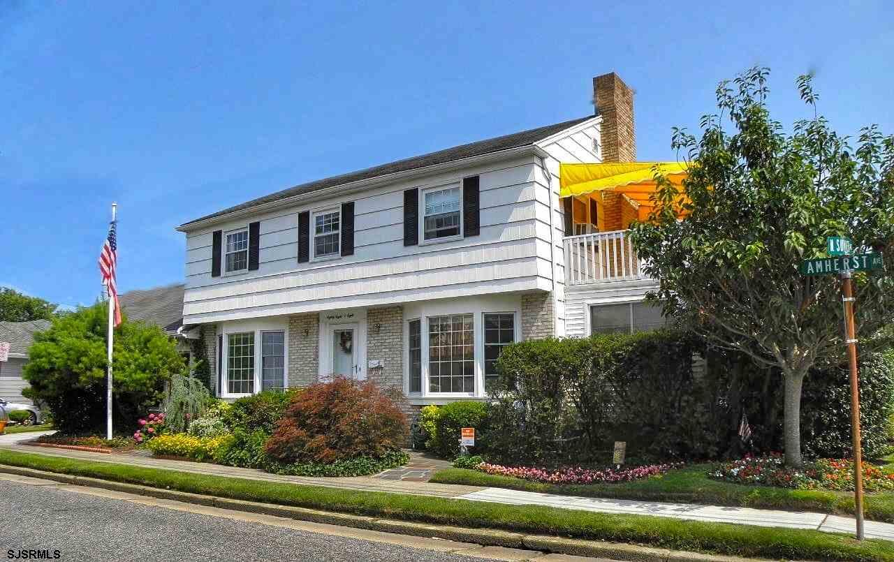 Situated on a 38' x 80' lot, this three bedroom, two and a half bath home celebrates its passage of time with a floor plan that has evolved over the years to meet the needs of its successive owners. Additions have created versatile spaces and the renovations highlight a harmonious blend of yesterday and today. The first floor boasts hardwood floors, bay windows and lots of space for entertaining. There is a living room with a fireplace, a tiled Florida room and a wood-paneled den, a dining room and a large kitchen. This main floor also includes a powder room and a laundry room with access to the attached garage. The second floor master bedroom suite features a large walk-in closet (large enough to serve as an office or sitting area!), a private bathroom and an awning-covered deck with bay views. The two additional bedrooms share a hall bath. Other highlights include two storage attics, an attached garage and a newer roof. Close to beach and bay, this home can be lived in as-is or can be torn down to create a new construction with spectacular bay views!