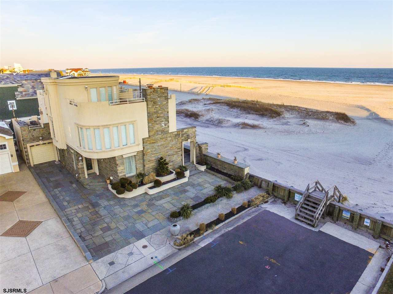 Direct Oceanfront Parkway location! This home has many options for luxury living and your taste or lifestyle! Spectacular one of a kind luxury beach front single family home features include 80 feet of direct beach front, unique third floor deck, 5 bedrooms, 6.5 bathrooms located in the prestigious parkway section of Margate. Property features custom luxury kitchen with huge wrap around breakfast bar, hardwood floors, blue stone beach front patio, large master suite over looking the beach, each bedroom features its own bathroom and private beach front deck, multi-zone heat and central air, one car garage with 5+ car parking in driveway. Enjoy life at the beach from every-room in the property.