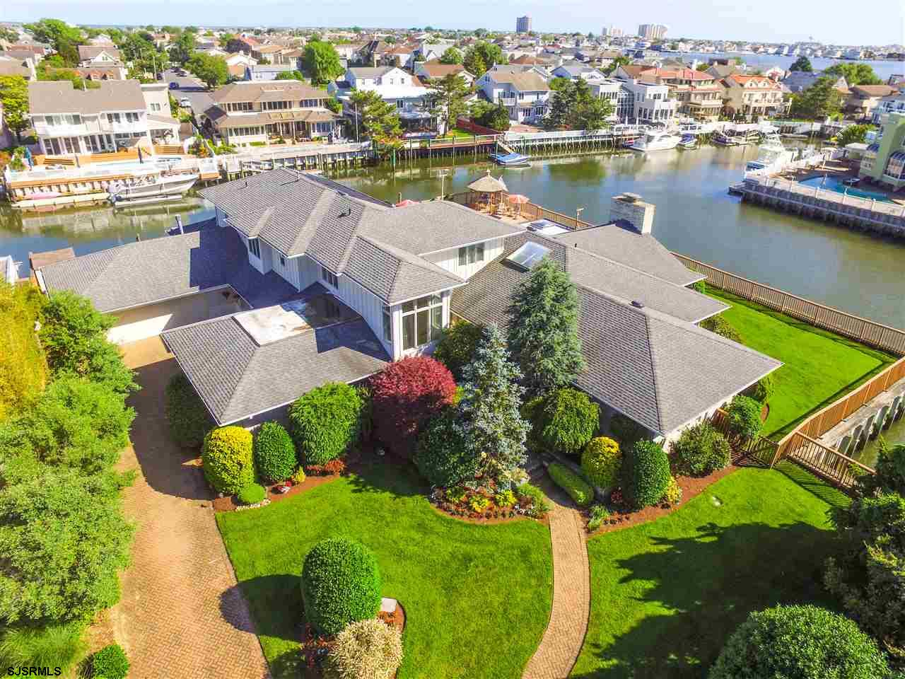 The Crown Jewel of Bayshore Drive with its premier waterfront location at the very end of this private cul-de-sac! Experience the enchanting water views from one of the most exclusive addresses along the water in all of Margate! You'll love the magnificent outdoor living with expansive terrace, in-ground pool, hot tub, gazebo and easy access to the two docks with multiple boatslips. Inside this sprawling 6,700 sf luxury bayfront home, no expense was spared when Regina Builders recently renovated it and added onto it. The 2-story home boasts an extended great room with separate sitting room and sun room with teak ceilings, dining area and gourmet kitchen with beveled-edge granite countertops, center island and double ovens, features 4 master bedroom suites along separate wings of the home for added privacy and hard-to-find space for the entire family to spread out, along with 3 more additional bedrooms for a total of 7 bedrooms throughout. The home also offers an attached 2-car garage and additional parking in the driveway. This special waterfront residence has incredible WATER views everywhere you turn!