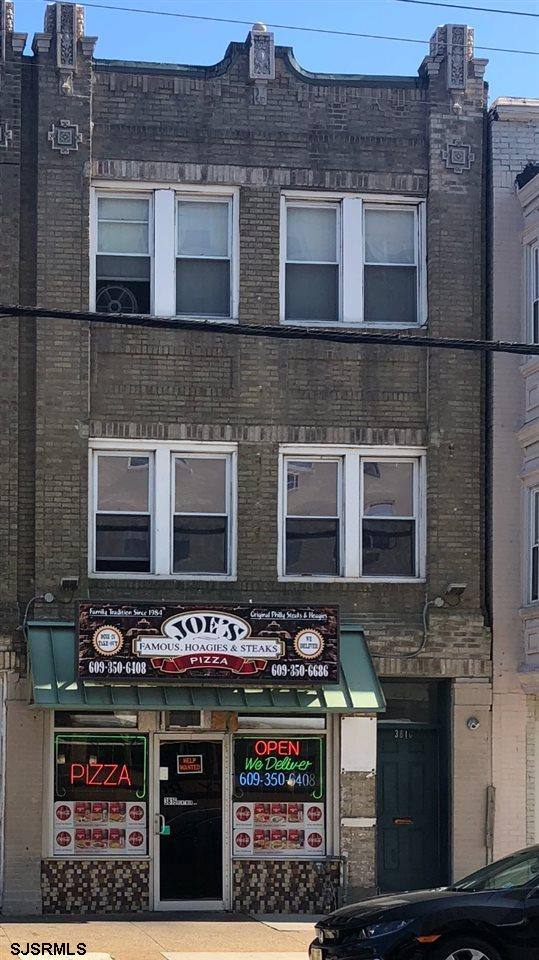 Excellent opportunity for investor, Close to Stockton College, Casinos & Boardwalk. 2 Nicely kept apartments above commercial space that is currently occupied with month to month tenancy. Long time commercial renter on 1st floor.