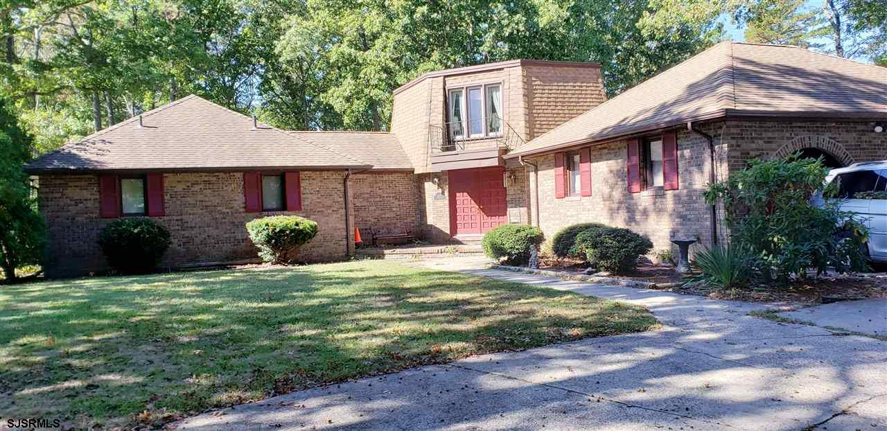 Brick 2,381 square foot ( tax recorders) brick rancher located on 1.4 acres 158 x 426.  This home offers 3 bedroom with a loft or 4th bedroom, 2 full bath(1 master)plus   1 half bath.  Formal living room, dining room, eat in kitchen, family room w/ brick fireplace, large utility room and 2 car attached garage.   All city utilities:  natural gas, city water and sewer. 2 decks and  newer large shed.  Conveniently located,    close to schools, malls, shopping, Garden State Park, Atlantic City Expressway, beaches and parks,