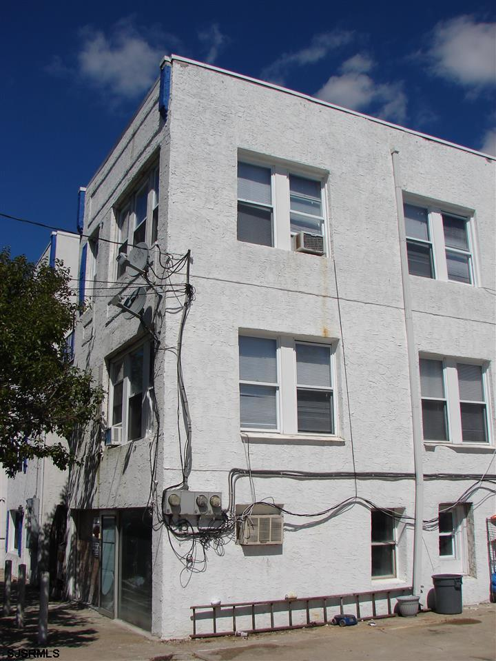 MONEY MAKER next to new Stockton campus  !!! Second and third floor units are 2 and 3 bedrooms with one bathroom.The 1st floor is office space, including a large space with a full bath, all redone. . Parking spaces available in front of building. Fully rented.