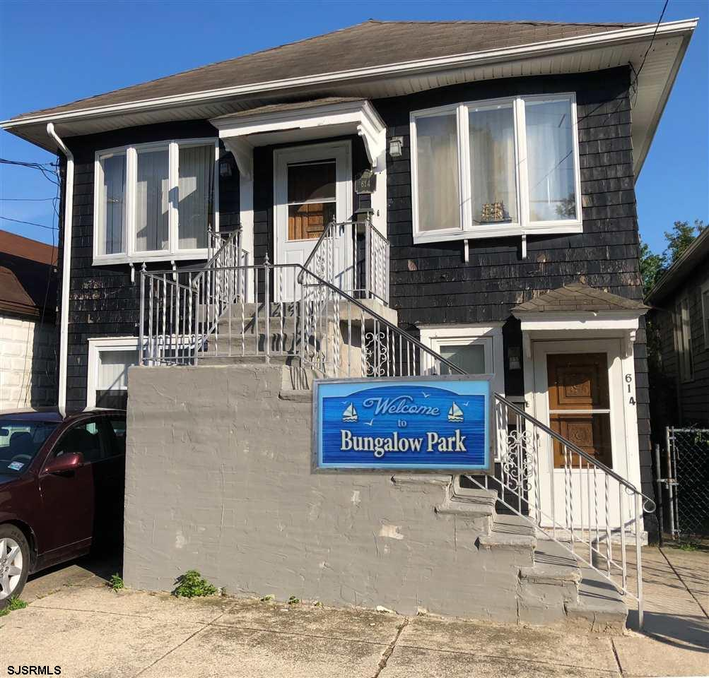CLOSE TO SNUG HARBOR AND GARDENER'S BASIN, this 2 story home offers an updated lower level 2 BR apt that includes a front entrance area, dining room, eat-in kitchen, LR, 2 BR's and a bath.  There are separate meters for each apt. The 2nd floor offers a front foyer, spacious LR, formal dining room, an eat-in kitchen, plus 3 BR's, a full bath and storage. Home is being sold AS IS, with the buyer responsible for all inspections and certifications. Off street parking for one car, too!  PLEASE NOTE - EVEN THOUGH IT MAY BE SET UP AS TWO APARTMENTS - IT IS NOT ON FILE WITH THE CITY AS A LEGAL DUPLEX. BUYERS must apply for a certificate of non-compliance.   There is a true likelihood of it eventually being used as a money making DUPLEX, however, it