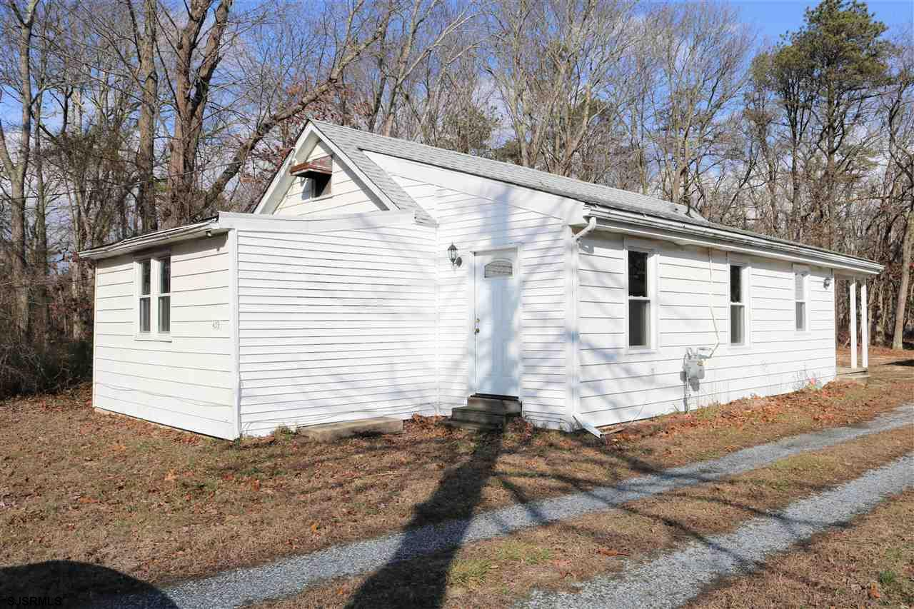 2 additional lots are included:  the lot the house is on is 48 x 134 (lot 27), the lot directly behind and adjacent (lot 28) 48 x 198 and the lot directly behind on the other side of Vera (lot 40) 50 X 330.  The White House was remodeled about 8 years ago at the time new windows, new electric:  service line, meter, electric box and panel, kitchen, bathroom.  The septic is about 2 months old.  The 1 car detached garage the siding, doors are 5 years old and it has electric.  The White Horse is a move in ready home.