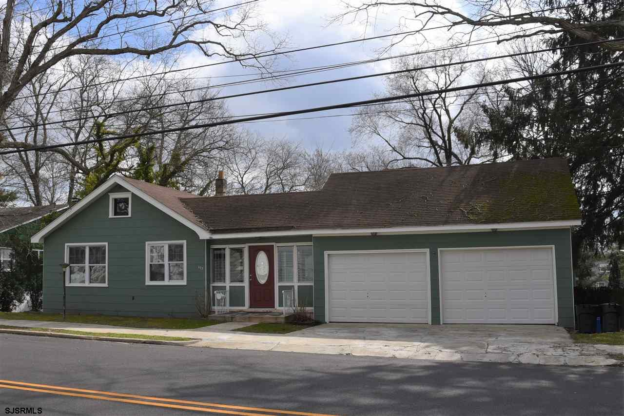 Built in 1933, this 3 bedroom 2 bath home maintains its old world charm with the original doors, pai