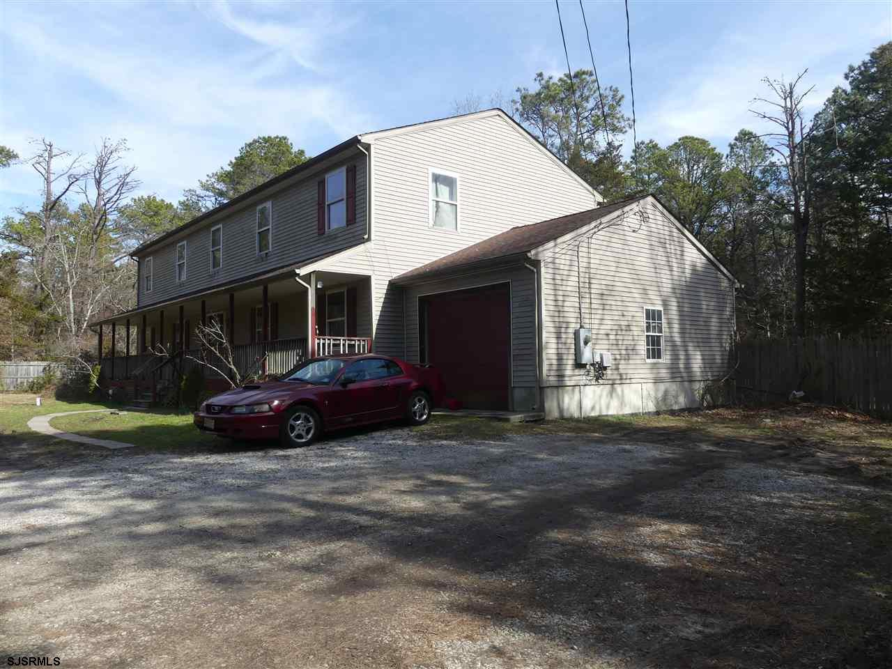 A great value with tons of potential. This Egg Harbor Township home is situated on a 200' x 200' pri