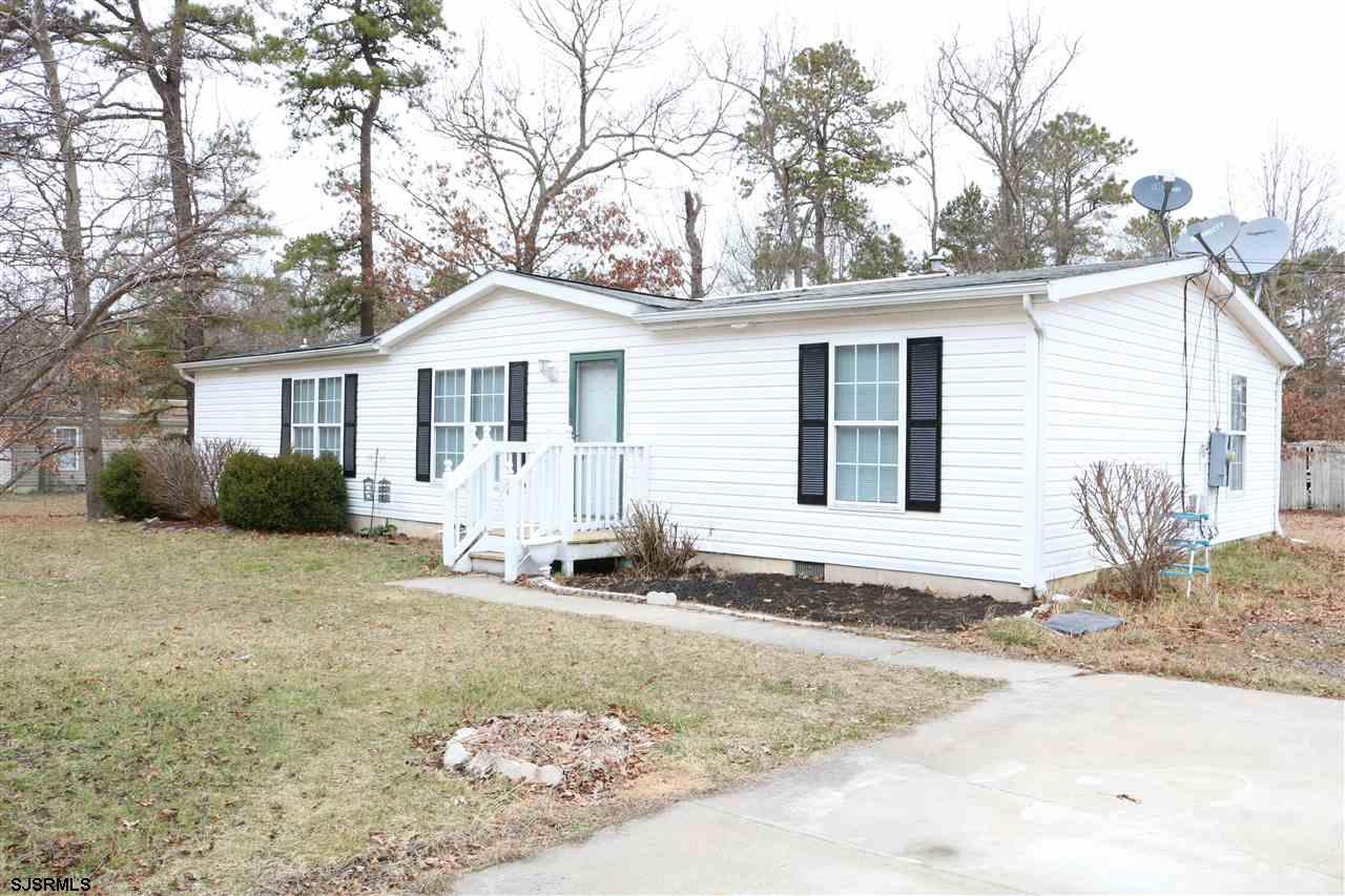 Nice 4 bedroom 2 bath Ranch in good condition. Home has fresh paint & new laminate flooring throughout. Nice sized bedrooms & easy to show. Washing machine is 'as is' and a dishwasher will be installed. Corner lot with shed and deck. This is a Manufactured home but not difficult to get a mortgage. if I recall Caliber Home loans and Meridian Bank can finance.