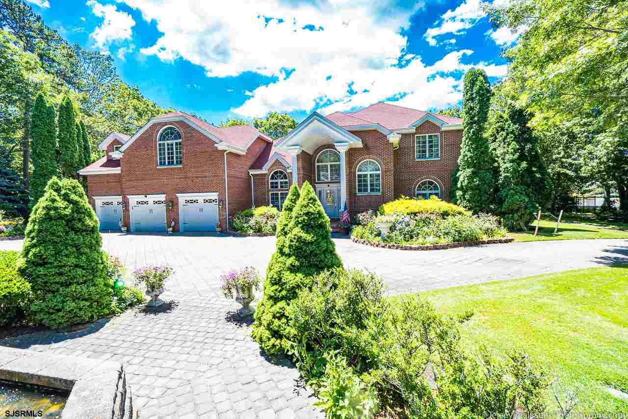 From the Moment you drive up the Circular Paver Driveway and enter this Grand and Gracious Custom Bu