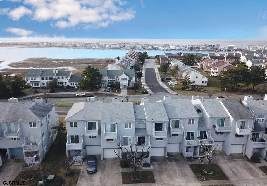 """NEW to market, Brigantine's highly sought-after Moorings multi-level 3BR & 2 ½"""" BA fee simple townho"""