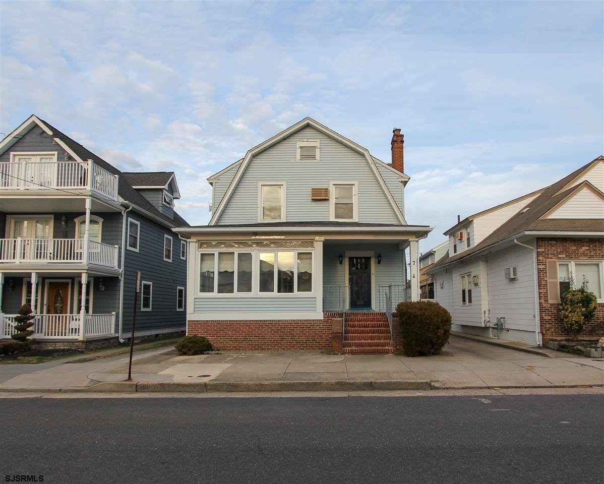 Located on the sunny-side of the street, just 2 blocks from the beach, sits this expansive 4 bedroom