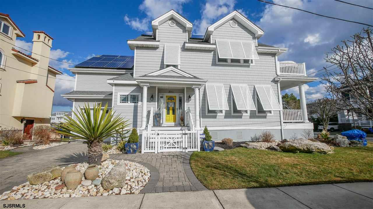 This Margate Parkway home with open bay views is an absolute gem! This large and spacious home is co
