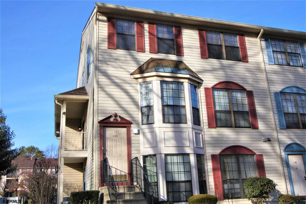 Bathed in Sunshine! Rare southern exposure, oversized two level condo. Located in the rear of the bu