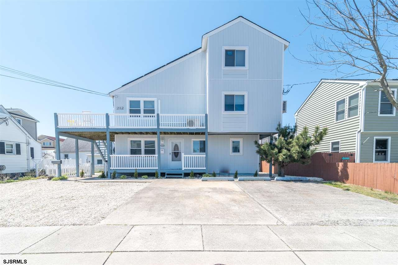 Newly renovated two bedroom one bath condominium beach block,   Steps to the Beach. Renovations incl